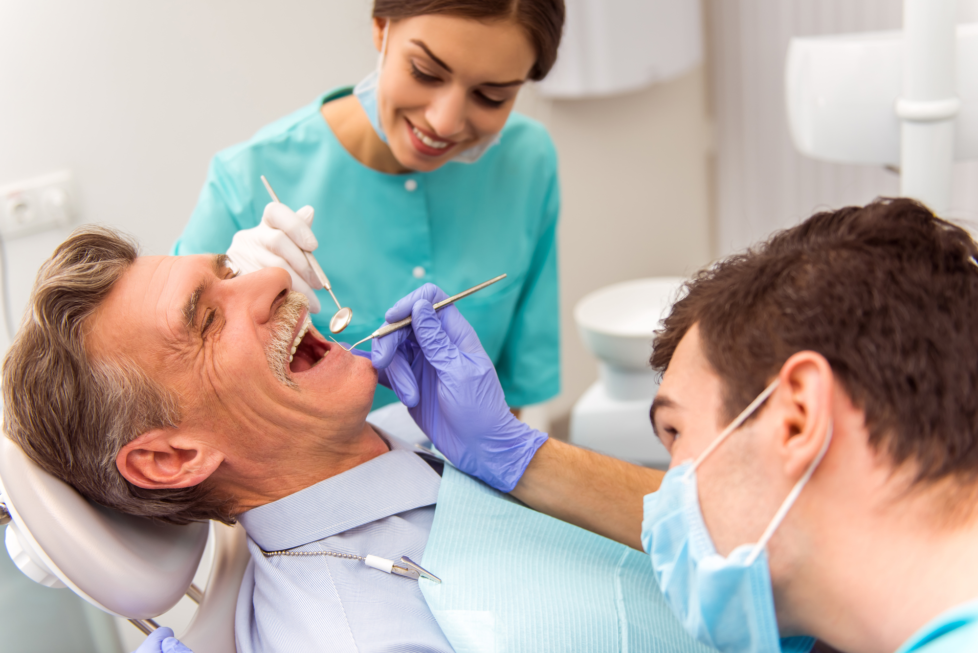Dental Implants in Palm Beach Gardens | Implants vs. Bridges