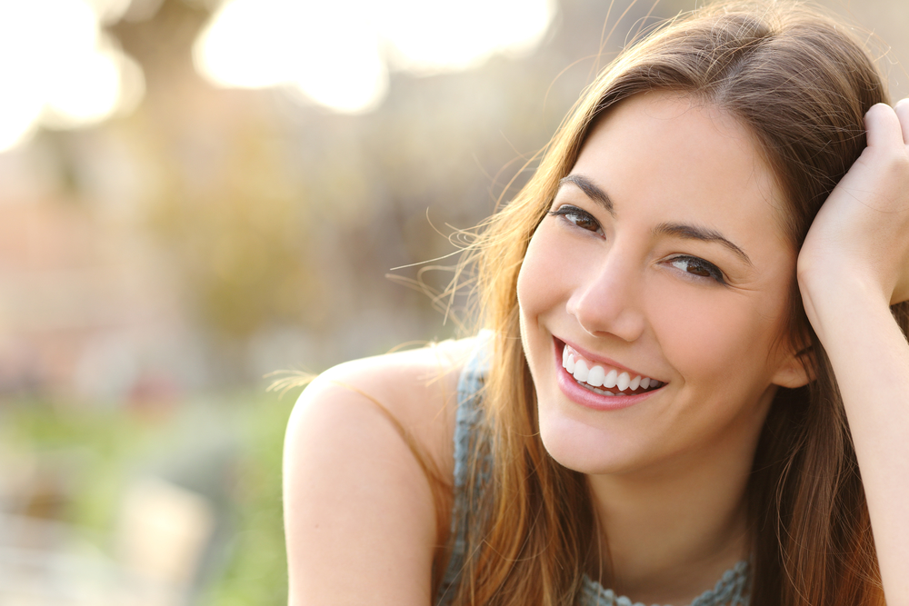 How can laser dentistry in Palm Beach Gardens improve my smile?