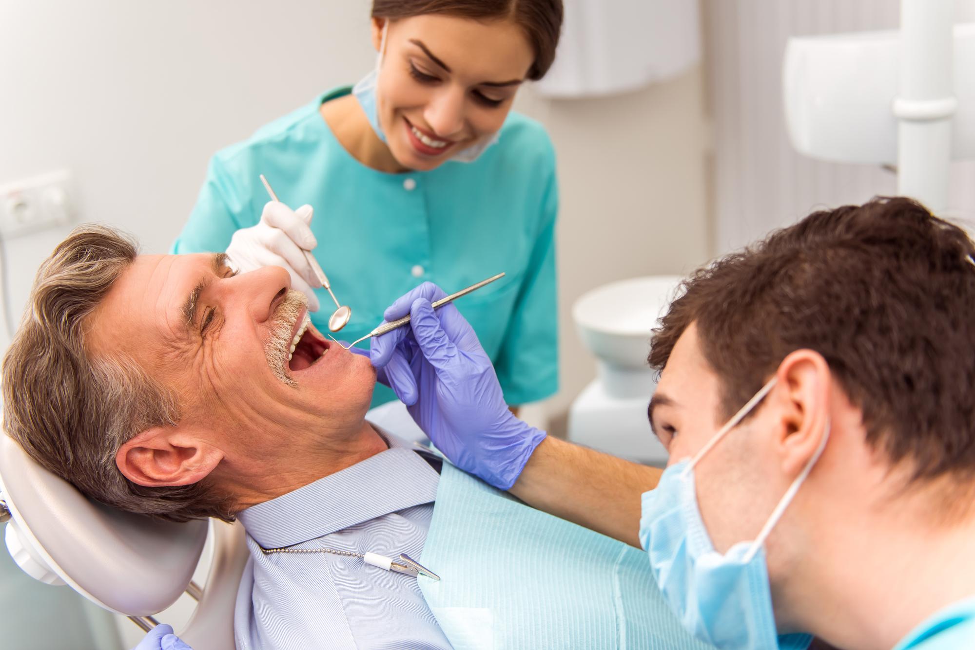 Dental Implants in Palm Beach Gardens | Implants vs. Bridges