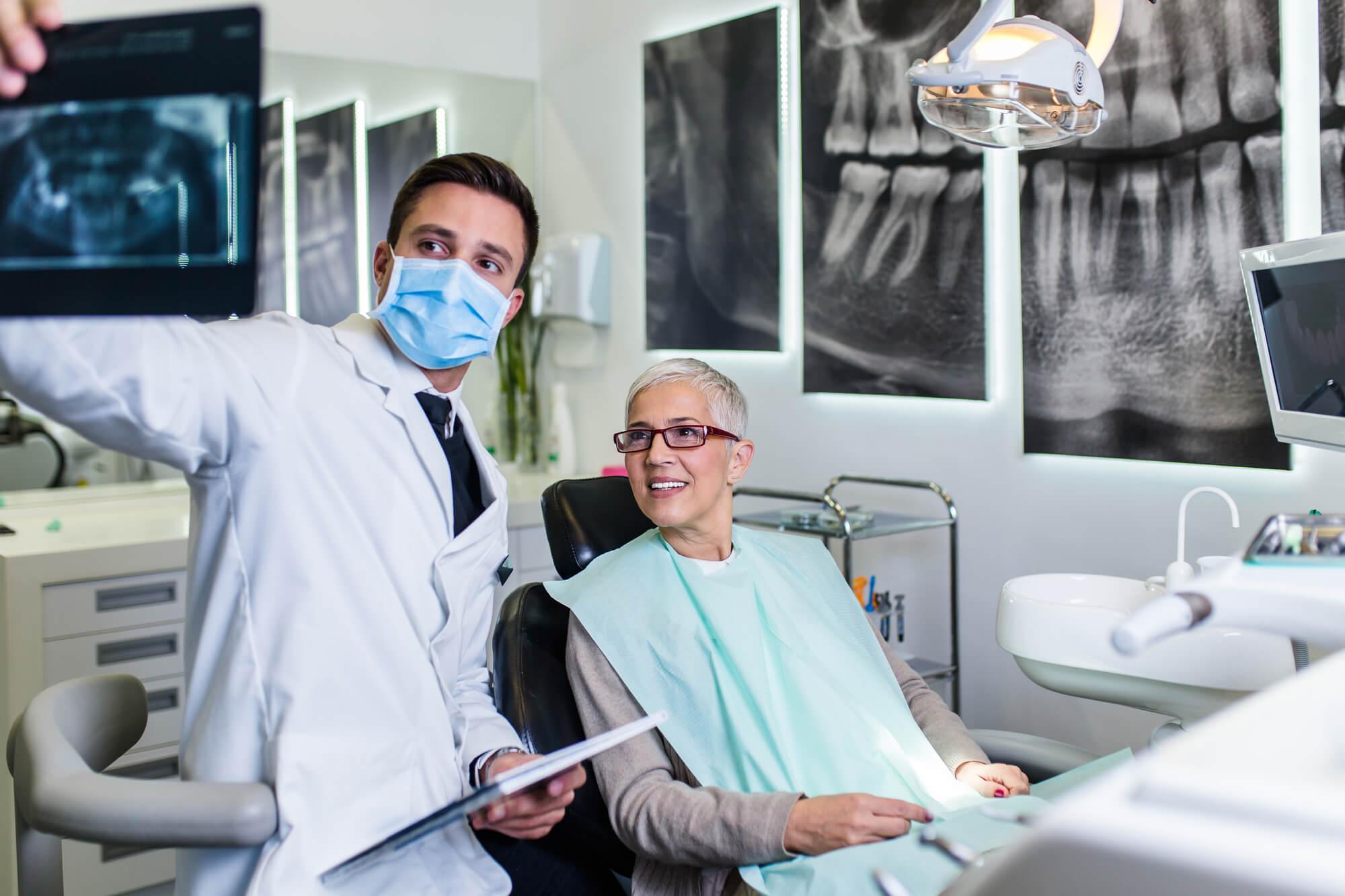 woman dental implants palm beach gardens