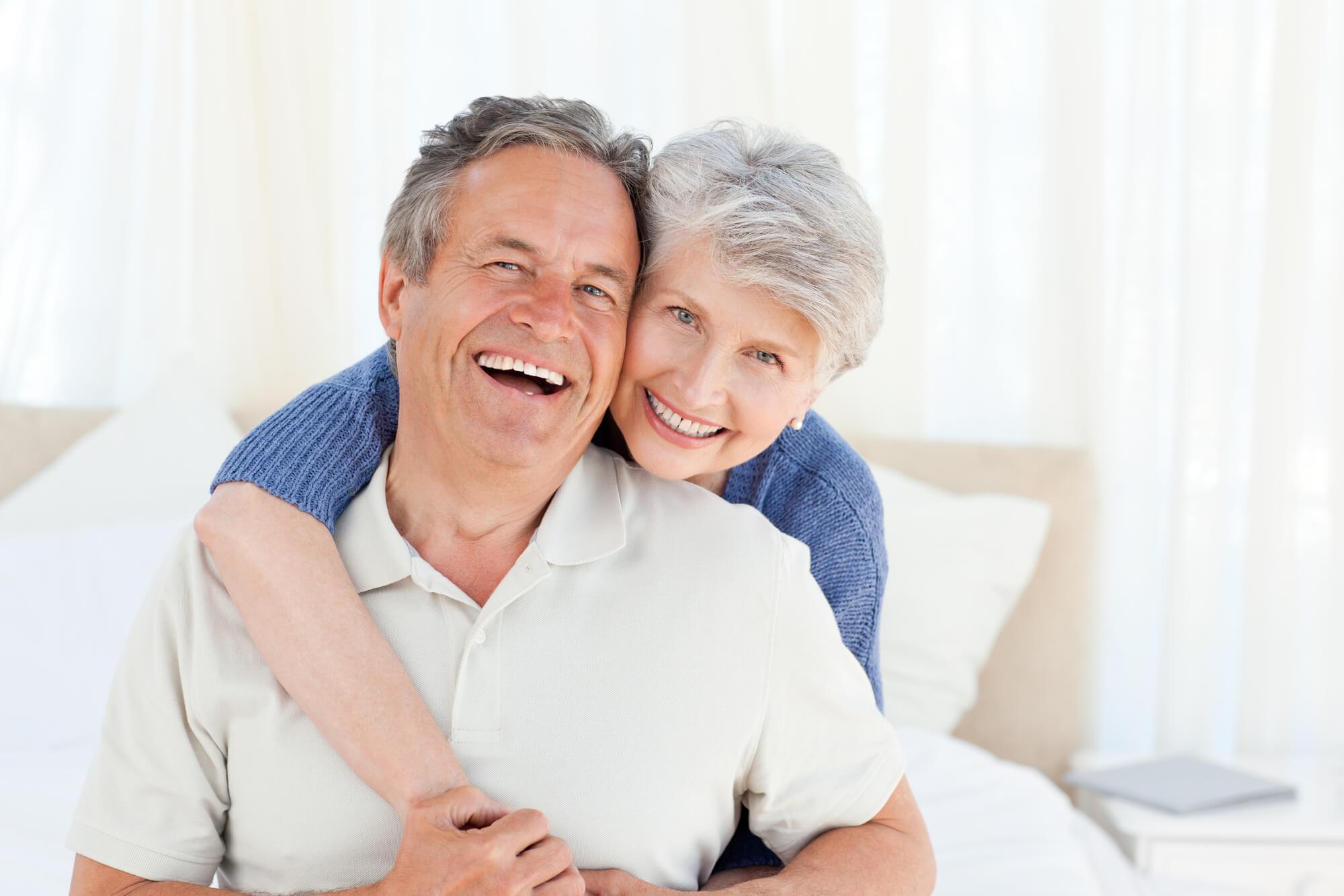 happy senior couple with Ceramic Implants Palm Beach Gardens