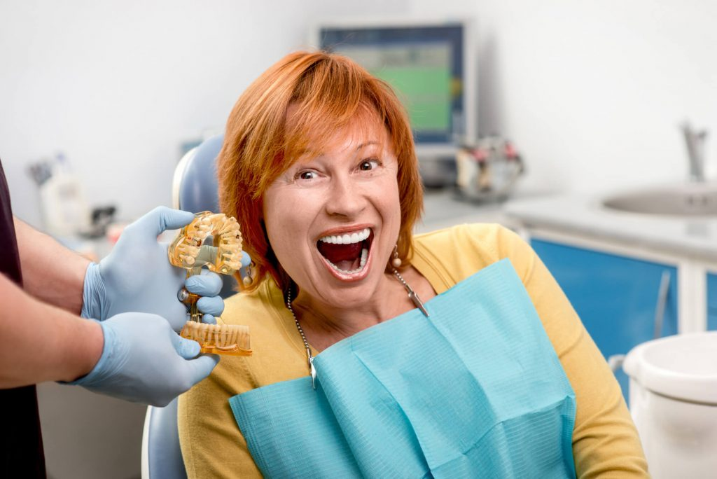 woman excited about getting Ceramic Implants Palm Beach Gardens